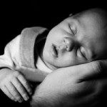 sleeping_baby_on_a_hand_199952-Copy-300x200